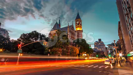 The Jefferson Market Library clock tower in evening, sunset to night with beautiful colors in Greenwich Village - 4K timelapse in NYC