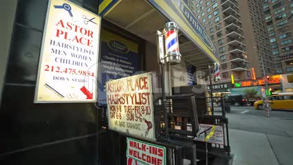 famous Astor Place barbershop sign with spinning barber pole on Broadway in Manhattan NYC
