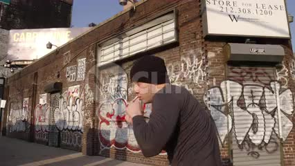 man boxing in front of graffiti building - sparring exercising outside on west side of Manhattan in 1080 HD and 4K NYC