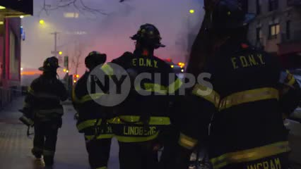 firefighters walking toward smoke - FDNY firemen in uniform at night in 1080 HD and 4K in NYC