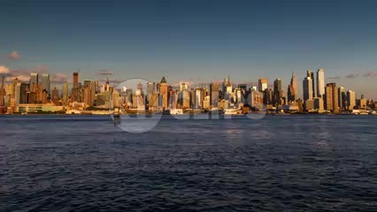 Midtown Manhattan skyline skyscrapers going from day to night in timelapse pushing in slowly with sunset in 1080 HD and 4K NYC