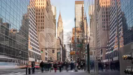 Chrysler Building view from busy 42nd street in Midtown Manhattan - zooming out day to night timelapse in 1080 HD and 4K NYC
