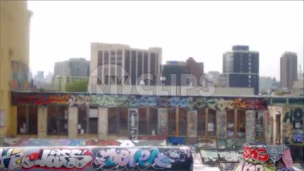 5 pointz in Queens from moving 7 subway train - gritty graffiti building in neighborhood in NYC