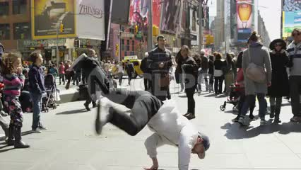 breakdance windmills in Times Square with crowd watching - Asian man breakdancing in Manhattan in 1080 HD and 4K NYC