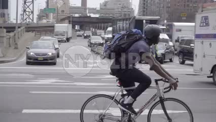 man on bicycle riding on east side of Manhattan in traffic in 1080 HD NYC