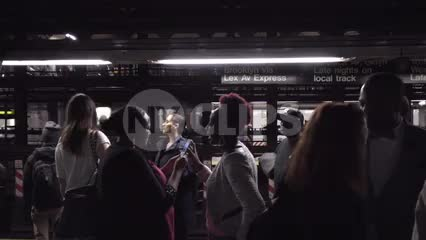 diversity on subway train platform - black women sharing smartphone photo in 1080 HD in NYC