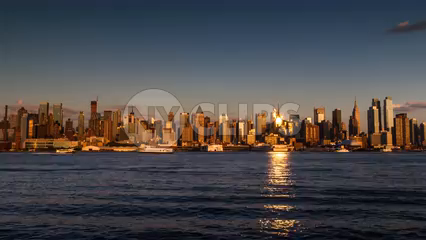 Midtown Manhattan skyline from across East River - day to night timelapse in 4K New York City