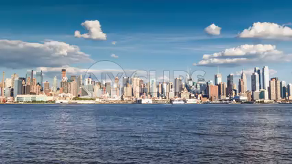 Manhattan skyline from day to sunset to night across East River water - 4K timelapse of skyscrapers