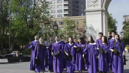 students graduating throwing caps in air - girls in cap and gown in Washington Square Park celebrating graduation in 1080 HD and 4K NYC