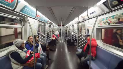 interior subway train with passengers sitting - moving through MTA carriage with steadicam in 1080 HD NYC