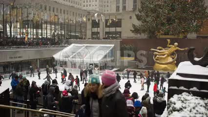 ice skating rink in Rockefeller Center on holidays, Christmas time with tourists during day in NYC