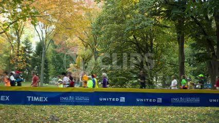 colorful scene with Marathon runners in beautiful Central Park spring with changing leaves 1080 HD in NYC