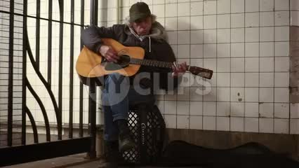 blues guitarist in subway - musician playing guitar in the train station 1080 HD in NYC