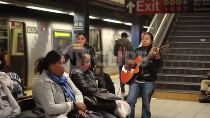 Latin musicians playing music in NYC subway station - South American performers in 1080 HD