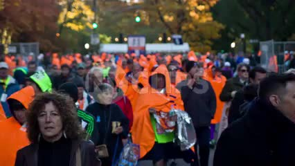 men in orange ponchos after Marathon in Central Park - crowd of people walking 1080 HD in NYC