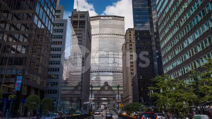 Met-Life Building and Grand Central Station Terminal clock on Park Ave with cars - 4K timelapse in Midtown