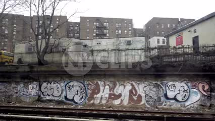 moving subway view of graffiti on urban walls in poverty stricken neighborhood in Brooklyn 1080 HD NYC