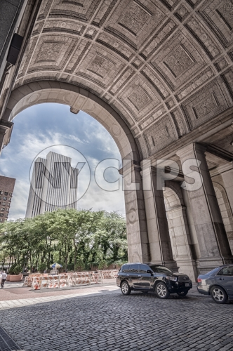 Manhattan Municipal Building arch in Downtown with cobblestone street in NYC