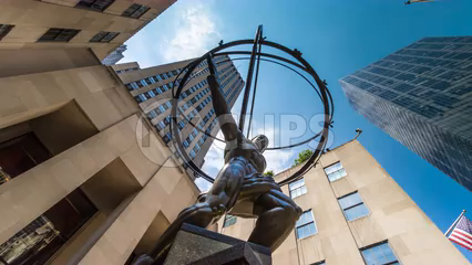 Atlas statue upward angle outside Rockefeller Center in Manhattan, timelapse in 4K and 1080 HD NYC