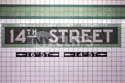 14th street sign on tiled wall in subway station in NYC