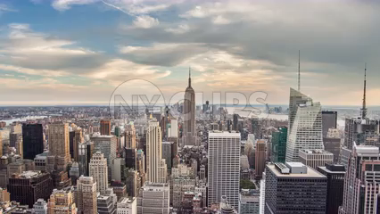 zooming out from Empire State Building cityscape 4K timelapse day to night - skyscrapers in Manhattan