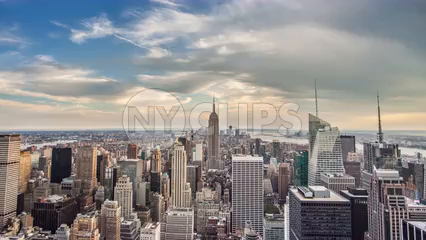 Empire State Building cityscape tilting down 4K timelapse day to night - skyscrapers in Manhattan