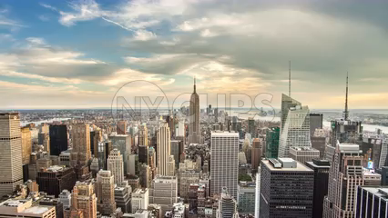 zooming in on Empire State Building cityscape 4K timelapse day to beautiful red sunset night sky - skyscrapers in Manhattan