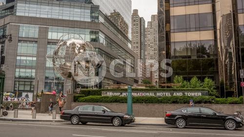 Columbus Circle with famous globe sculpture and Trump International Hotel and Tower - Midtown Manhattan on sunny summer day in NYC