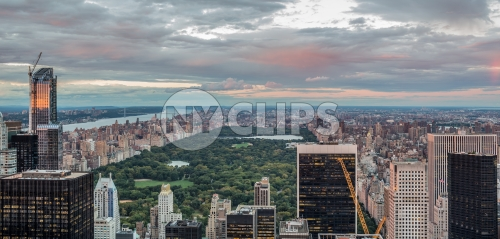 Central Park from aerial high view with buildings and skyscrapers at sunset in Manhattan NYC