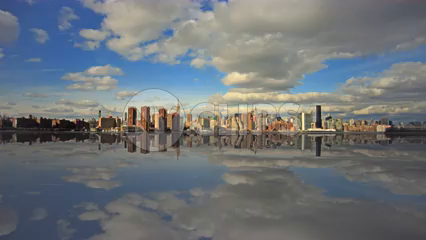 amazing artificial reflection of Manhattan skyline in river water - timelapse during the day - skyscrapers in 4K