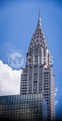 Chrysler Building close-up with bright sunny blue sky day in Midtown Manhattan NYC