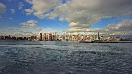 Manhattan skyline timelapse during the day from across river water - skyscrapers in 4K