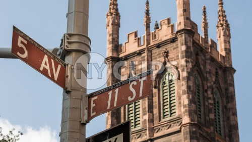 First Presbyterian Church on 5th Ave and 11th Street signs on corner in Manhattan