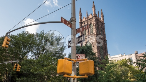 intersection of 5th Ave and 11th Street with First Presbyterian Church on sunny day in Manhattan