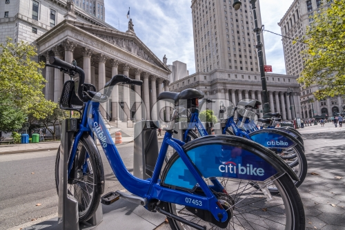 Citi Bikes parked at docking station downtown outside courthouse in Manhattan