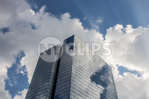 glass condominium in the Bronx on blue sky