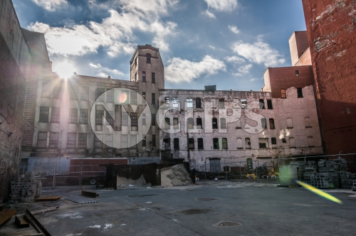 poverty stricken Harlem courtyard in Uptown Manhattan ghetto - broken down abandoned building