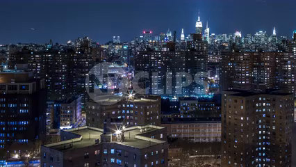 panning Manhattan skyline at night from LES red brick housing project buildings - 4K timelapse