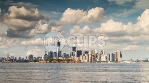 Manhattan skyline with Freedom Tower under construction and skyscrapers with blue sky and beautiful fluffy clouds