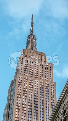 Empire State Building on bright blue sky during day