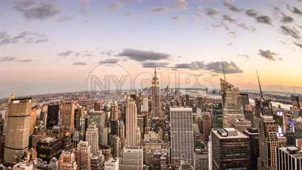 round fisheye wide angle view of Empire State Building and Manhattan cityscape at beautiful sunset - 4K skyscrapers tilting down