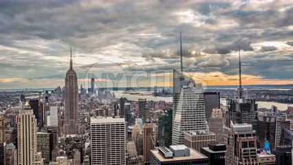 beautiful clouds passing in sky over Manhattan cityscape with Empire State Building at sunset in 4K timelapse