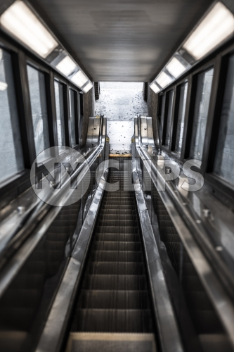 down escalator exiting 1 2 and 3 train in Harlem subway station
