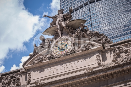 closeup shot of statue and clock on Grand Central Station Terminal exterior in Manhattan