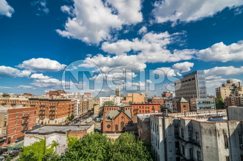 Harlem neighborhood with church from rooftop on bright beautiful sunny summer day in Uptown Manhattan, blue sky and clouds