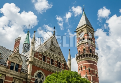 close up of Jefferson Market Library clock tower in Greenwich Village on bright blue sky day