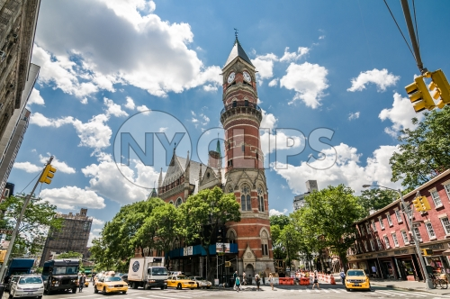 Jefferson Market Library clock tower in Greenwich Village on sunny day in summer