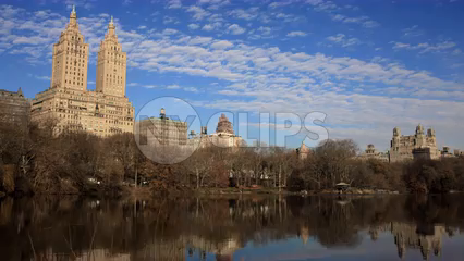 San Remo Building hotel over Central Park pond - 4K timelapse during day in Manhattan