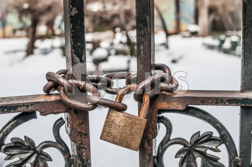 locked gate in Harlem on cold winter day, snow on ground
