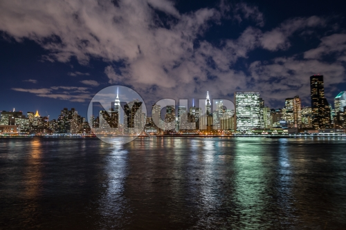 Manhattan skyline at night with East River